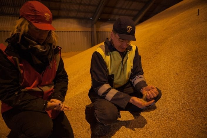 Kate with Mike in a barley store - Bairds Malt